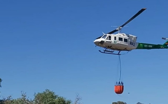 Un helicóptero de los que participaron en el dispositivo. Foto: NG