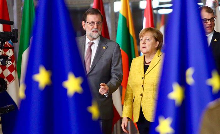 Rajoy y Merkel, en Bruselas