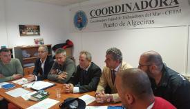El presidente de Puertos del Estado, Salvador De la Encina, con sindicatos del sector